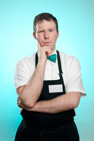apathetic: This image shows a slaes clerk with closed body language Stock Photo