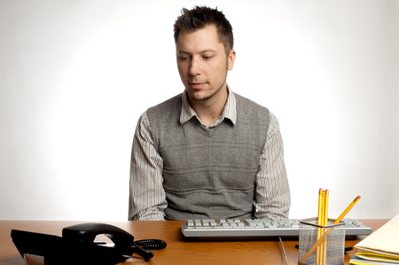 This image shows an office worker waiting for the phone to ring Stok Fotoğraf