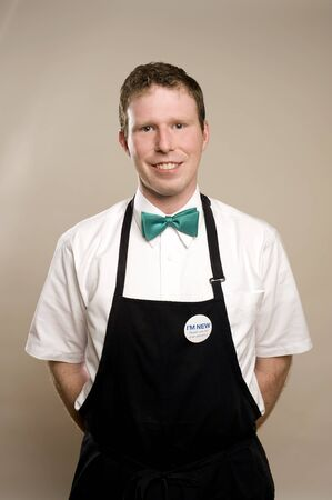 sales clerk: This image shows a sales clerk in an apron