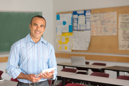 This image shows a Hispanic Male Teacher in his classroom Zdjęcie Seryjne - 40344442