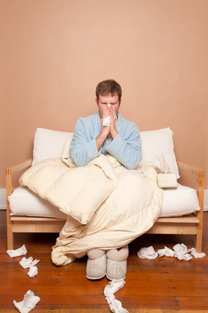 housecoat: This image shows a sick man on the couch