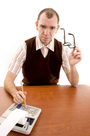 dweeb: This image shows an office worker at his desk witha  serious look. Stock Photo