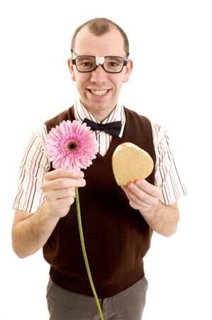 unfashionable: This image shows a nerd like guy offering a flower and gold box.