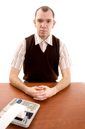 dweeb: This image shows a serious office worker with his hands floded at his desk. Stock Photo