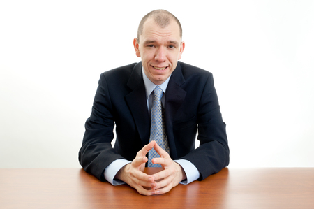 smirking: This image shows a smirking business man Stock Photo