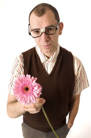 unfashionable: This image shows a nerd like guy offering a flower.