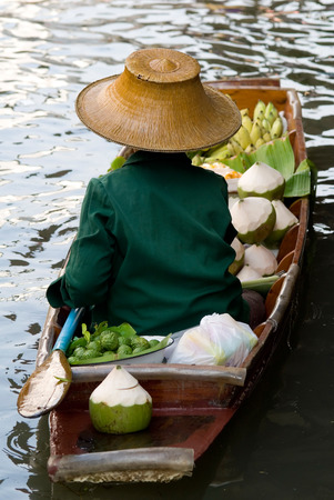 tradeswoman: This image shows a Damnoen Saduak Floating Market Vendor, Bangkok, Thailand Stock Photo