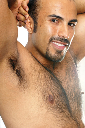 hairy male: This image shows a close-up portrait of a shirtless muscular Hispanic man. Stock Photo