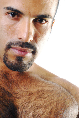hairy chest: This image shows a close-up portrait of a shirtless muscular Hispanic man. Stock Photo