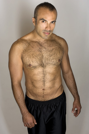 sixpacks: This image shows an attractive mucled hispanic man Stock Photo