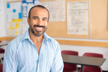 adult male: This image shows a Hispanic Male Teacher in his classroom