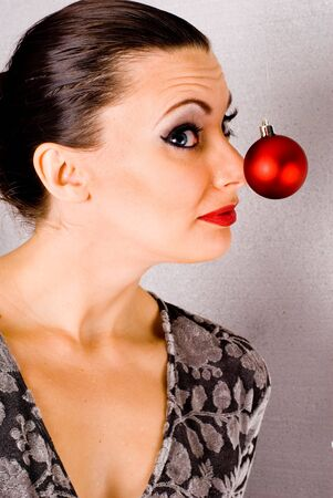 amongst: This image shows a pretty girl amongst Christmas Ornaments.