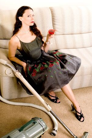 tempt: This image shows a vintage looking housewife apres housework