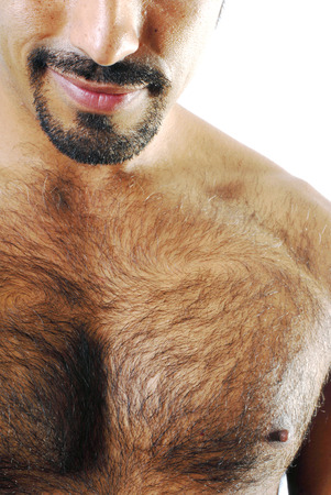 human chest: This image shows a muscular Hispanic man with a mischievous grin. Stock Photo