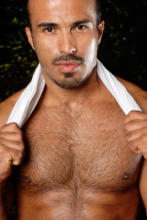 hairy chest: This image shows a well built Hispanic male in a work out pose.