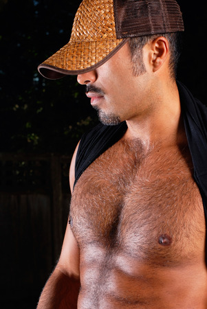 This image shows a muscular hispanic male. photo