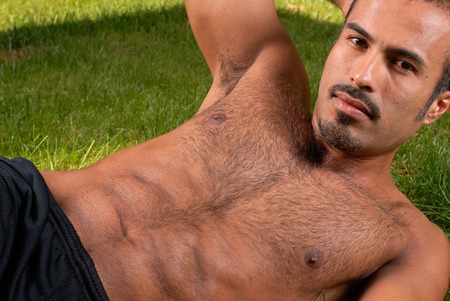 hairy arms: This image shows a muscular hispanic male.