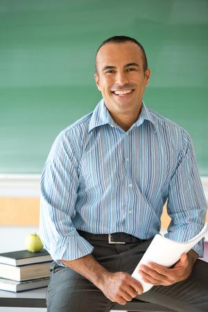 school teachers: This image shows a Hispanic Male Teacher in his classroom