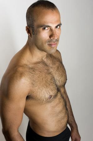 sixpacks: This image shows a sexy Hispanic man.