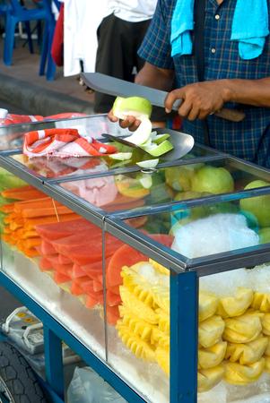 vendor: This image shows a Fruit Vendor Bangkok Stock Photo