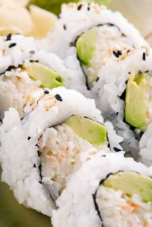 california roll: This image shows a California roll (sushi) on a plate.