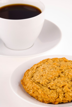 oatmeal cookie: This image shows an oatmeal cookie and Coffee Stock Photo