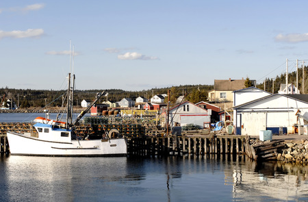 lobster boat: This image shows a Fishing Boat And Harbor
