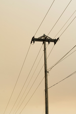 telephone pole: This image shows a Solitary Telephone Pole against Hazy Sky