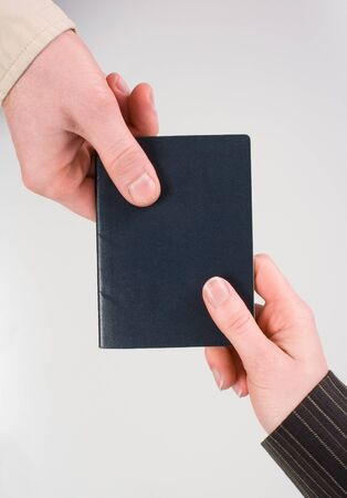 foreign nation: This image shows two people Passing Passport (Blank) Stock Photo