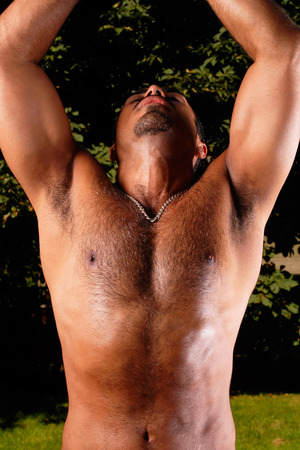 hairy chest: This image shows a muscular hispanic male after a work out.