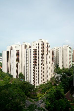 public housing: This image shows a public housing complex HDB in Singapore