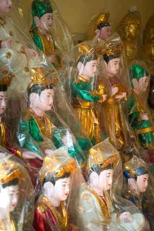 deities: This image shows Wrapped Deities ready to be sold in  Hanoi, Vietnam