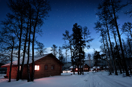 log cabin in snow: This image shows a log cabin in the snow, Canada Stock Photo