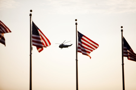 Silhouetted Washington Monument and Marine One Helicopter Stock Photo