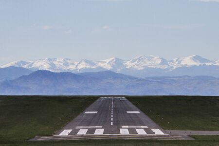 Airport Runway with Mountains in background