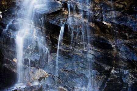 cascading: Water cascading down rock wall