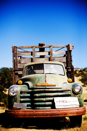 old green rusted truck in field photo