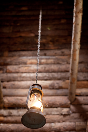 Hanging lantern outside of wood cabin