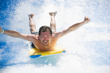 adrenaline rush: Man having fun laying on surfboard Stock Photo