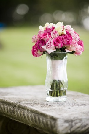 vase: Wedding bouquet of Roses and Cymbidium orchids in a vase