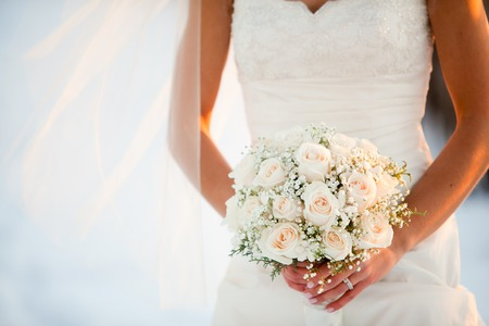 bridal bouquet: Bride holding wedding bouquet with Roses and Baby?s breath flowers Stock Photo