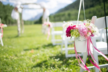 outdoors: Wedding flowers with Mini Hydrangea, Sweet pea, Blue Thistle, and Peonies Stock Photo
