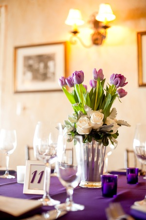 formal dinner: Purple tulips centerpiece at a formal dinner Stock Photo