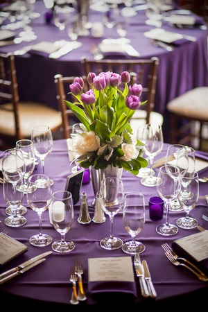 Purple tulips centerpiece at a formal dinner Stock Photo