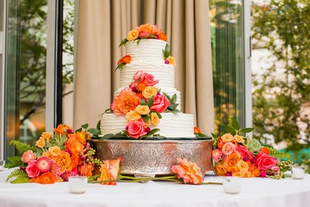 banquet table: Wedding Cake decorated with flowers Stock Photo