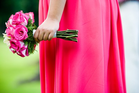 bridal bouquet: Bridesmaid holding bouquet of flowers