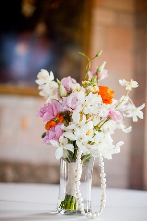 Vase Of Pretty Flowers Sitting On A Table Stock Photo Picture And