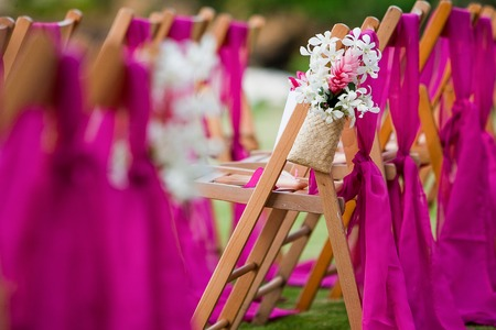 wedding chairs: White Dendrobium Orchid and Pink Ginger flowers on a wedding aisle for a destination wedding