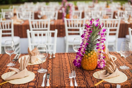 Tables and chairs at an outdoor event in a tropical location Stock Photo