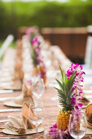 setting: Tables and chairs at an outdoor event in a tropical location Stock Photo